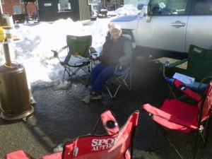 Karen's bundled up in layers trying to keep warm as we wait for people to stop for Free Prayer at Sundance Festival.